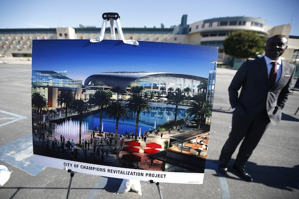 Hollywood Park project manager Gerard McCallum stands next to plans for development at the site of the former Hollywood Park Race Track at a news conference in Inglewood, Los Angeles