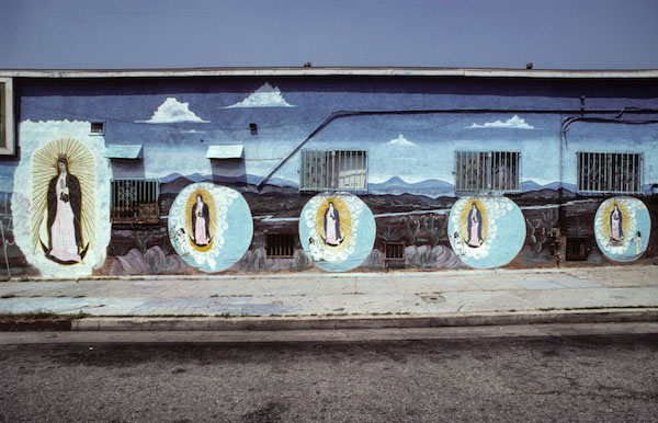 A litany of Virgins of Guadalupe, Fresno St., by Brooklyn, LA, 1997.  1994 mural by Manuel G. Cruz
