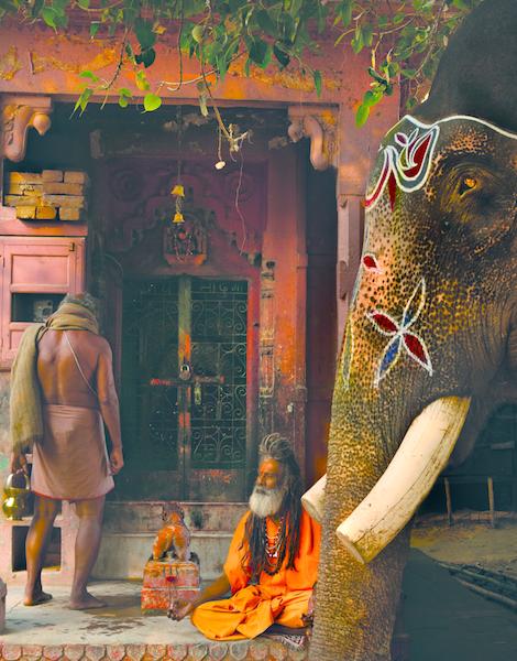 A small temple with a Hindu holy man. Varanasi, Uttar Pradesh.