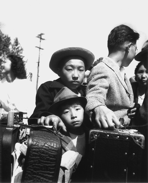 Dorothea Lange, Young evacuees of Japanese ancestry wait their turn for baggage inspection, Turlock, CA, 1942