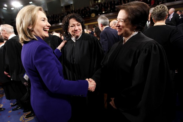 Secretary of State Hillary Rodham Clinton greets Supreme Court Justices Elena Kagan and Sonia Sotomayor prior to President Barack Obama's State of the Union address on Capitol Hill in Washington