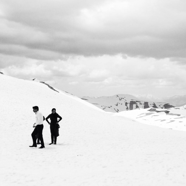 A family gathers near the summit of Mount Tochal near Tehran