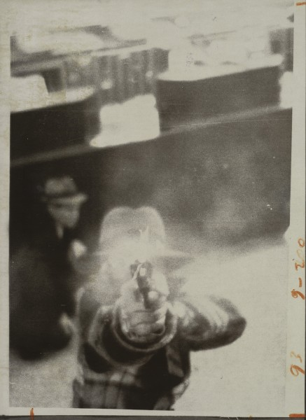 A bank robber aiming at a security camera in Cleveland, Ohio, in 1975
