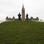 Royal Canadian Mounted Police officers stand guard on Parliament Hill in Ottawa
