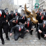 """A pack of """"wolves"""" surround the Wall Street Bull in 2014 in a nod to the hit movie The Wolf of Wall Street. Photo by Diane Bondareff/Invision for Paramount Pictures/Associated Press."""