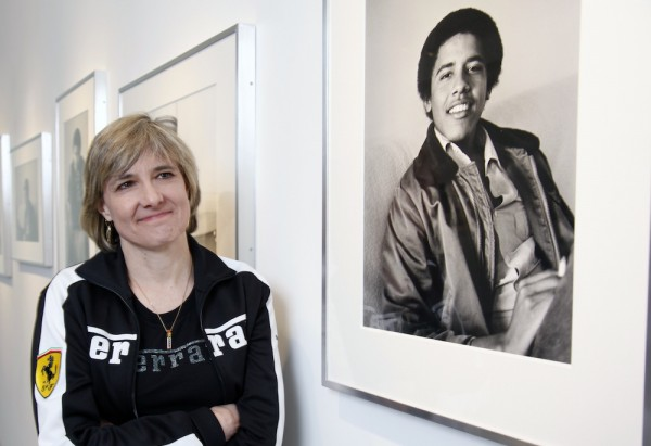 "Photographer Lisa Jack poses with her photos of ""Barack Obama The Freshman"" at the M + F Fine Arts gallery in West Hollywood in 2009. Photo by Damian Dovarganes/Associated Press."