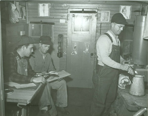 A conductor, flagman, and brakeman inside a caboose in 1948 in Allen County, Indiana.